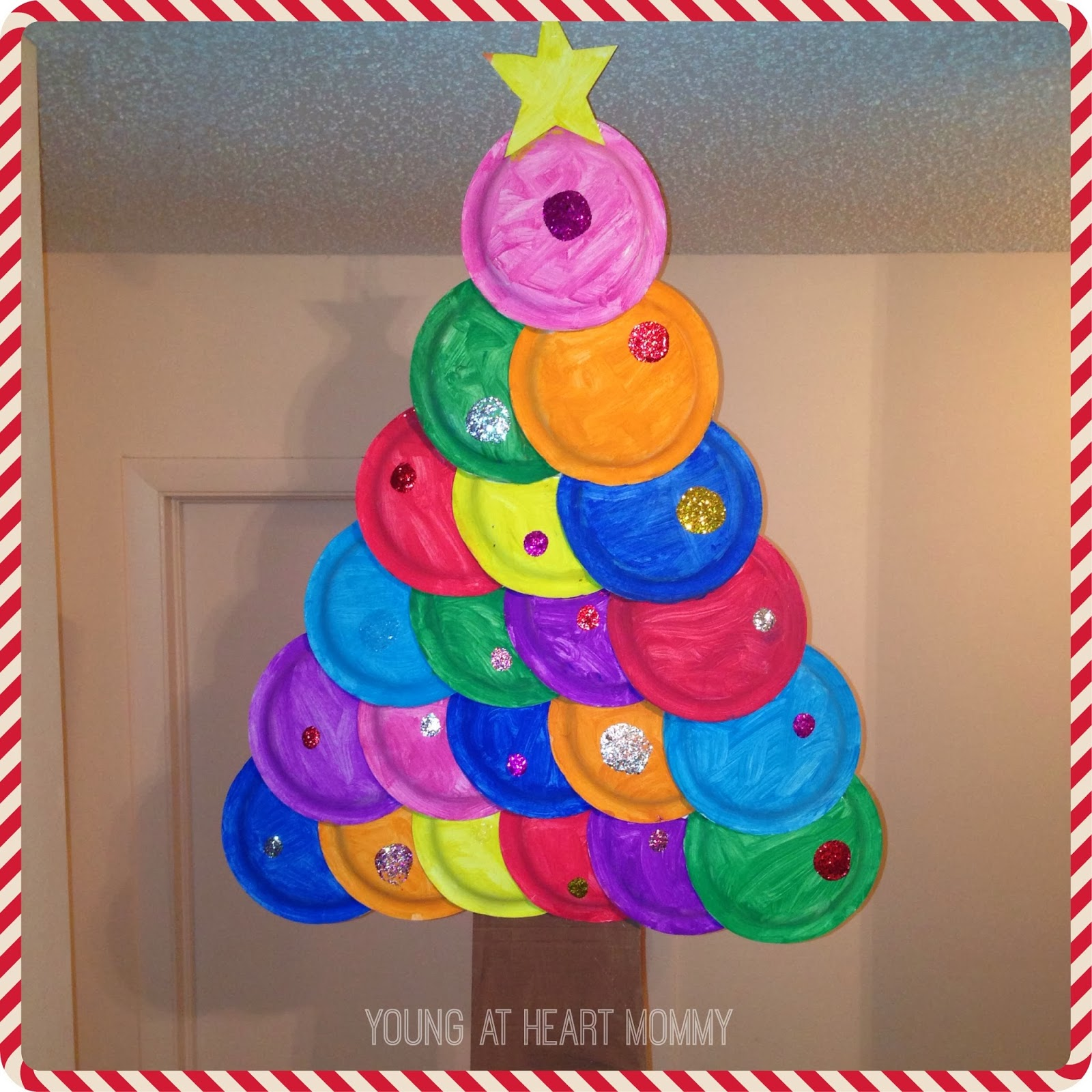 If you are going to hang the tree as decoration you may want to attach a fishing line or string to the back of the star.  sc 1 st  Young At Heart Mommy & Holiday Craft: Painted Paper Plate Christmas Tree! - Young At Heart ...