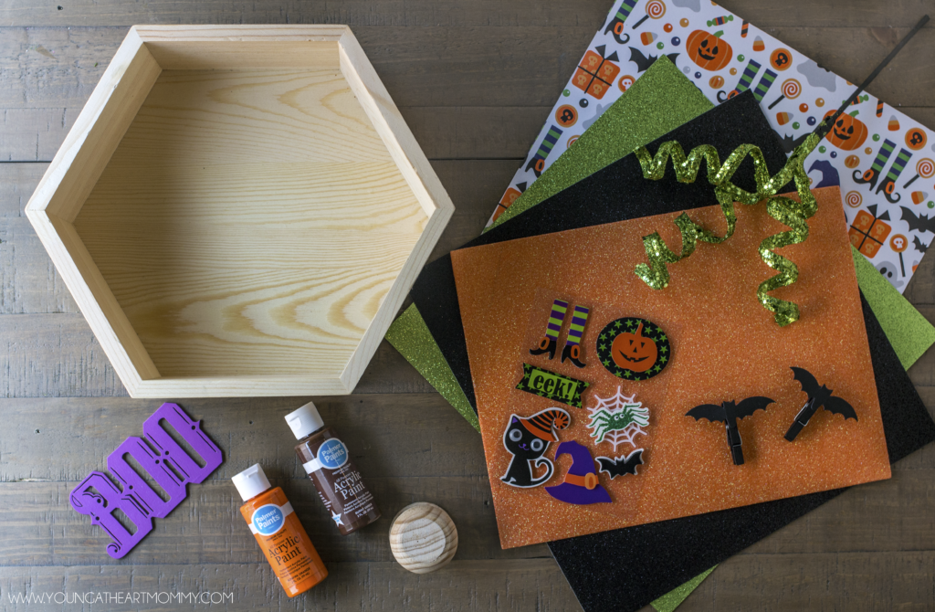 How to turn a wooden shadowbox into a pumpkin Halloween frame.